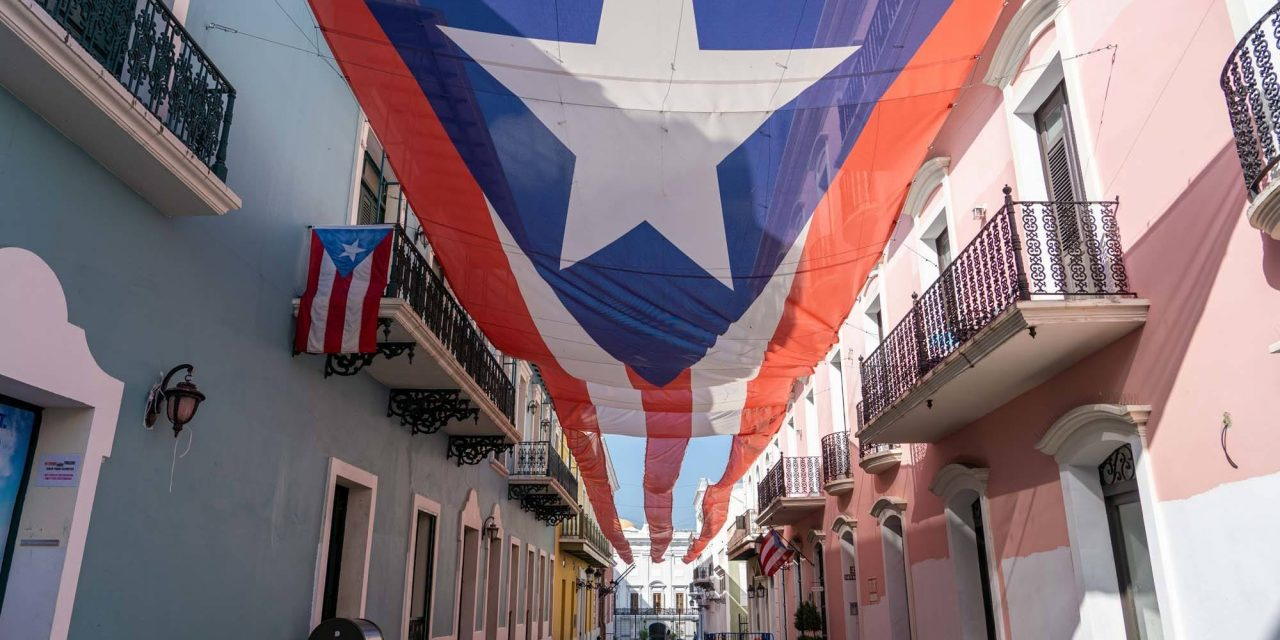 A POST CARD FROM SAN JUAN, AND THE DEMYSTIFICATION OF SOCRATES